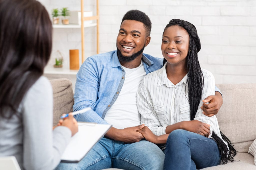 Counselor and happy african american couple after successful marital therapy
